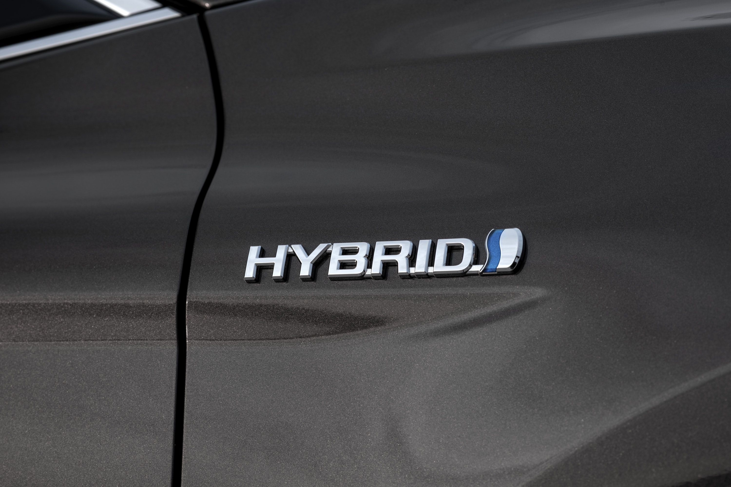 Close up of the Toyota Camry Hybrid badge