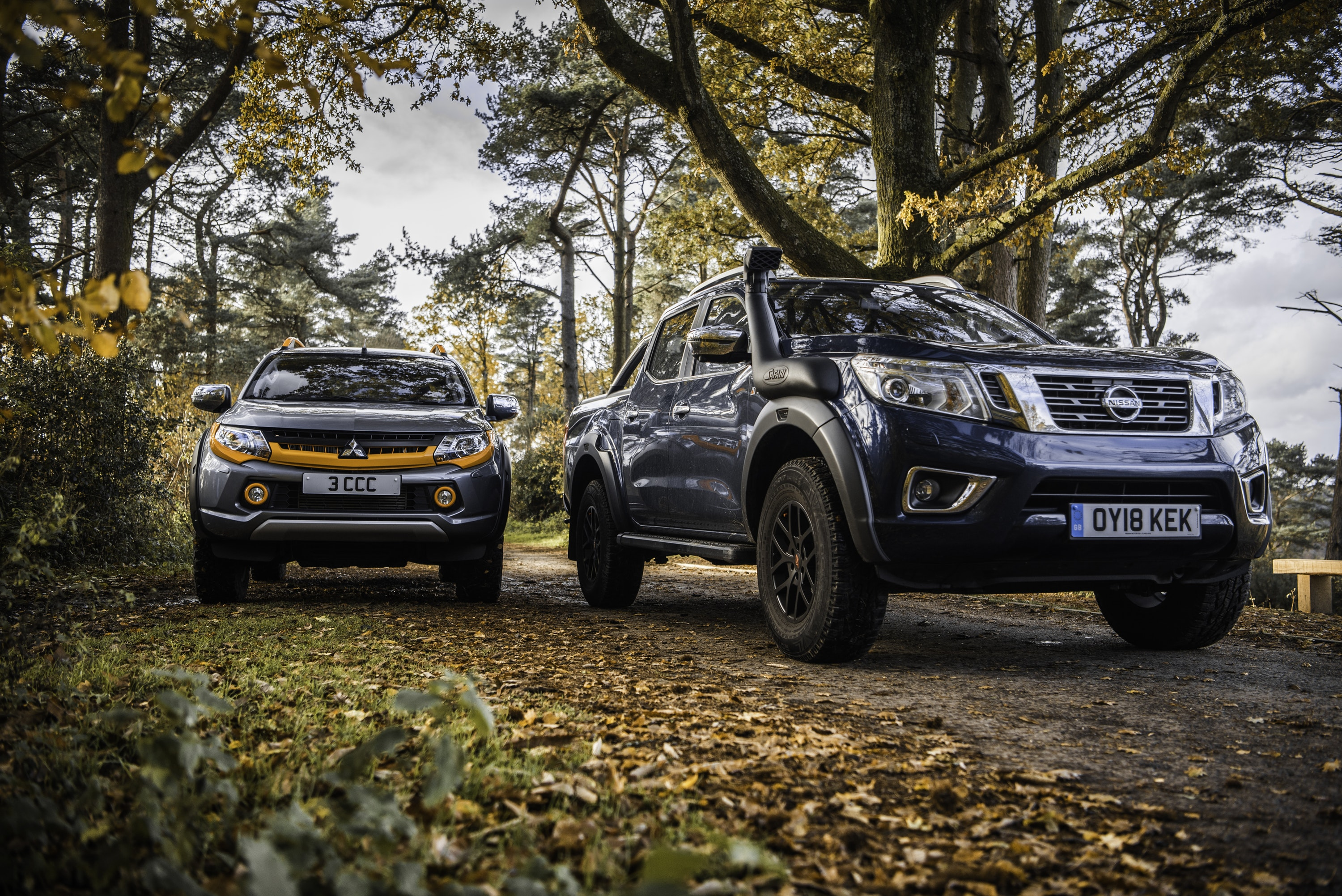 Front view of Mitsubishi L200 Barbarian SVP II and Nissan Navara AT32