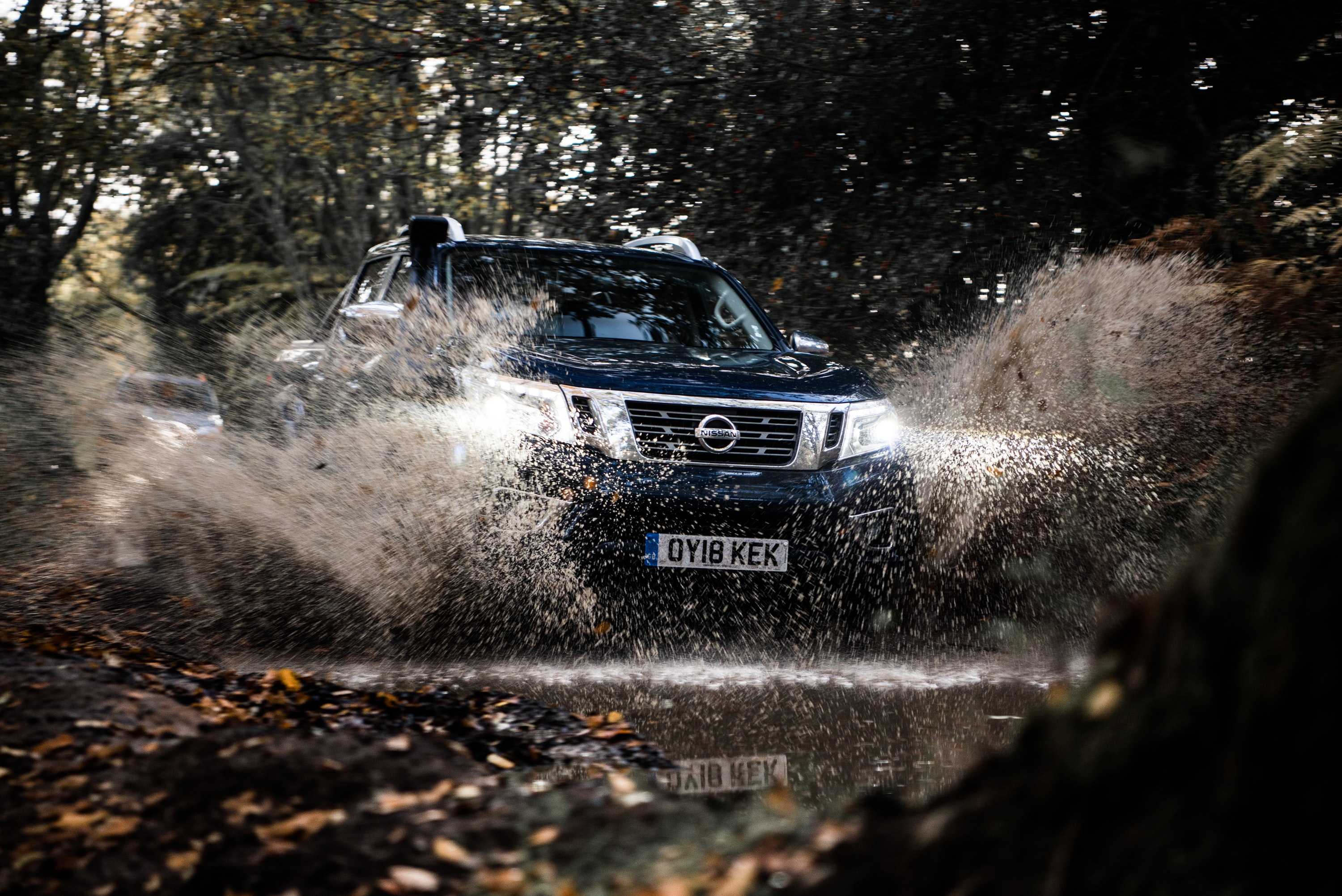 Nissan Navara AT32 splashing through a puddle