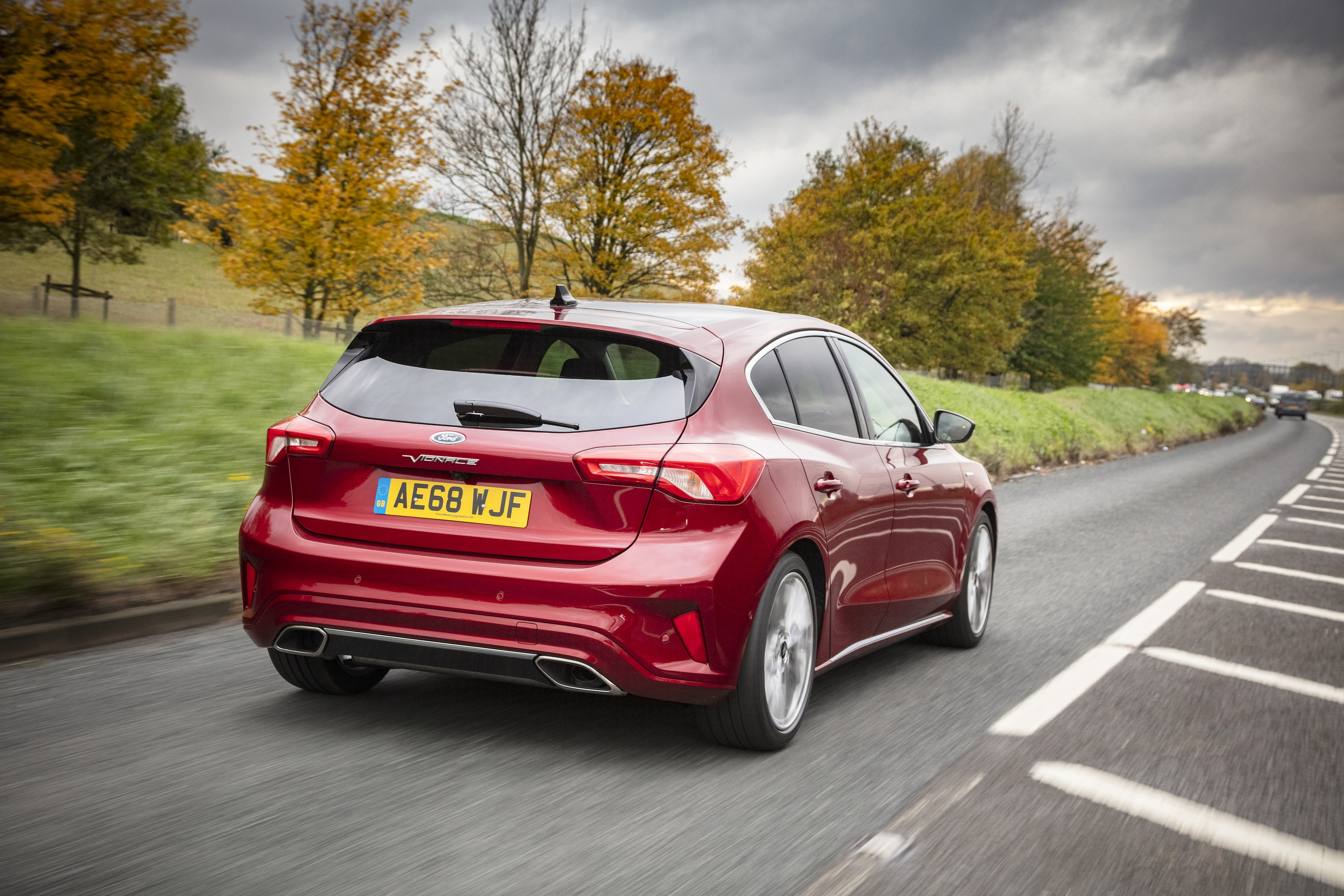Rear view of red Ford Focus Vignale