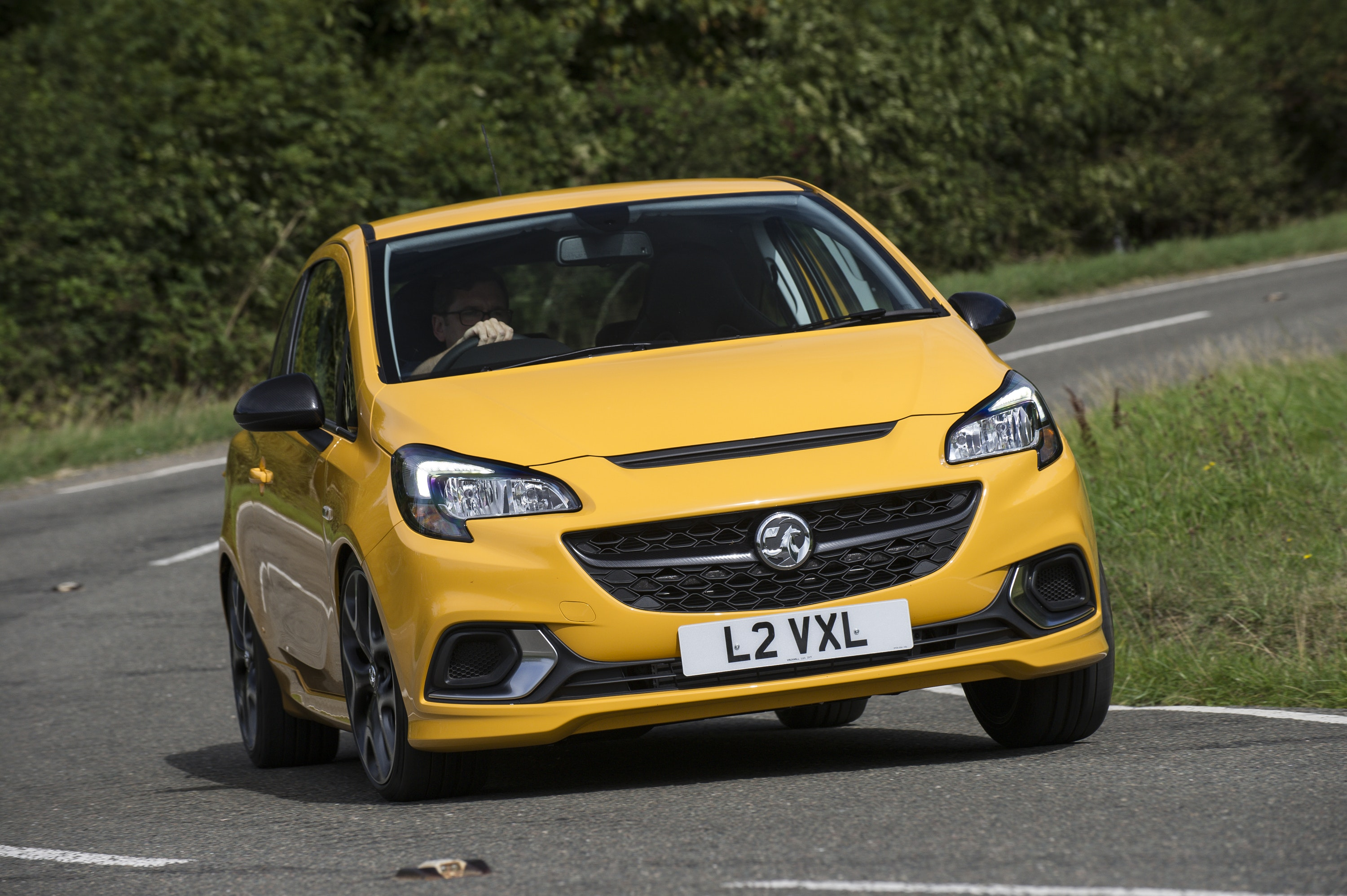 front view of Vauxhall Corsa driving on a road