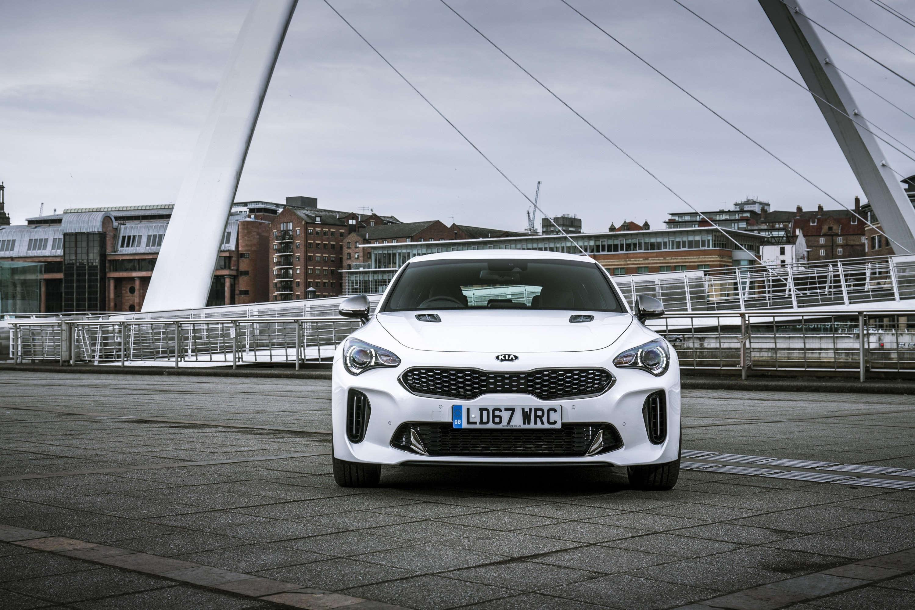 front view of a white Kia Stringer GT Line
