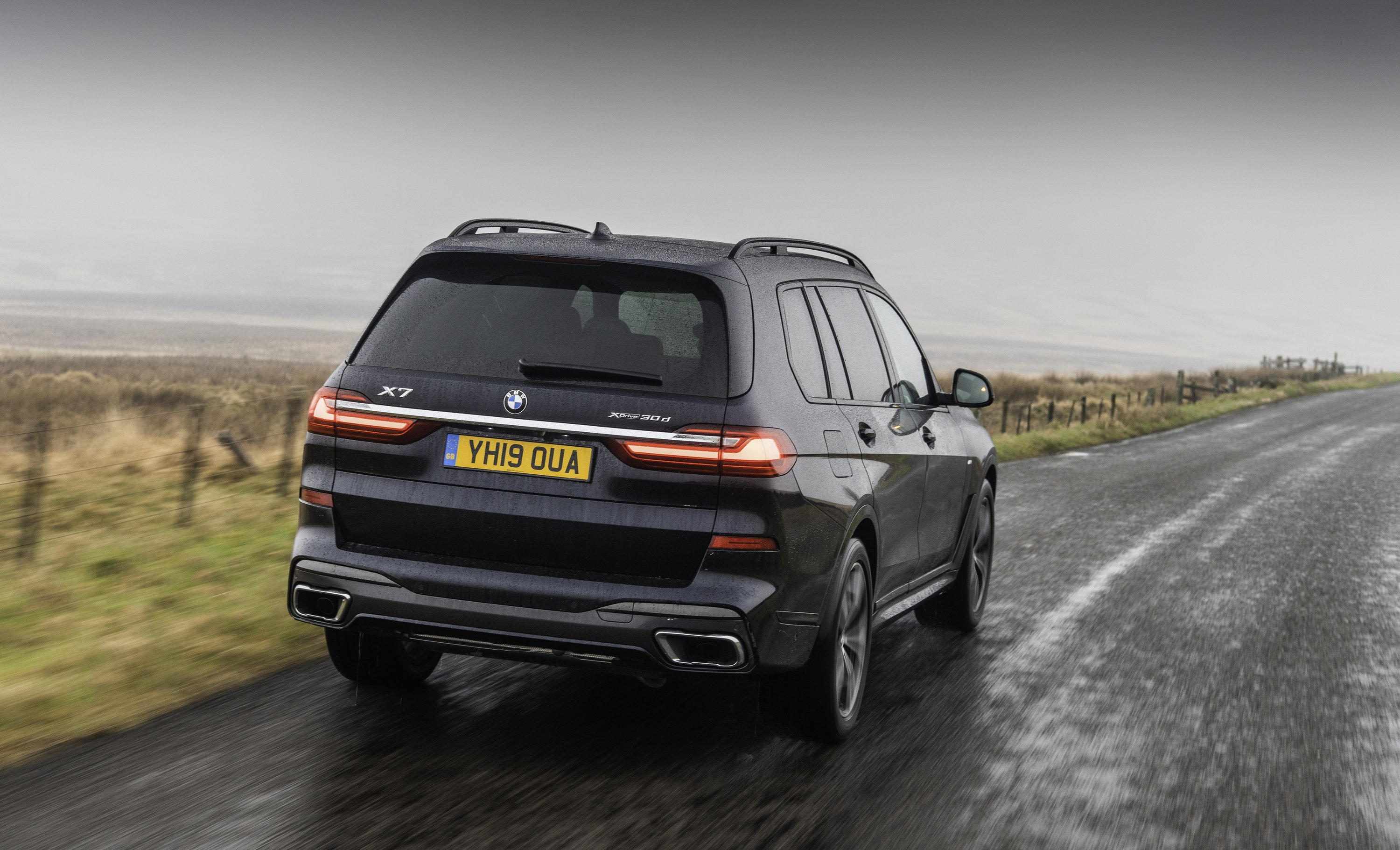 rear view of the BMW X7 driving on the road