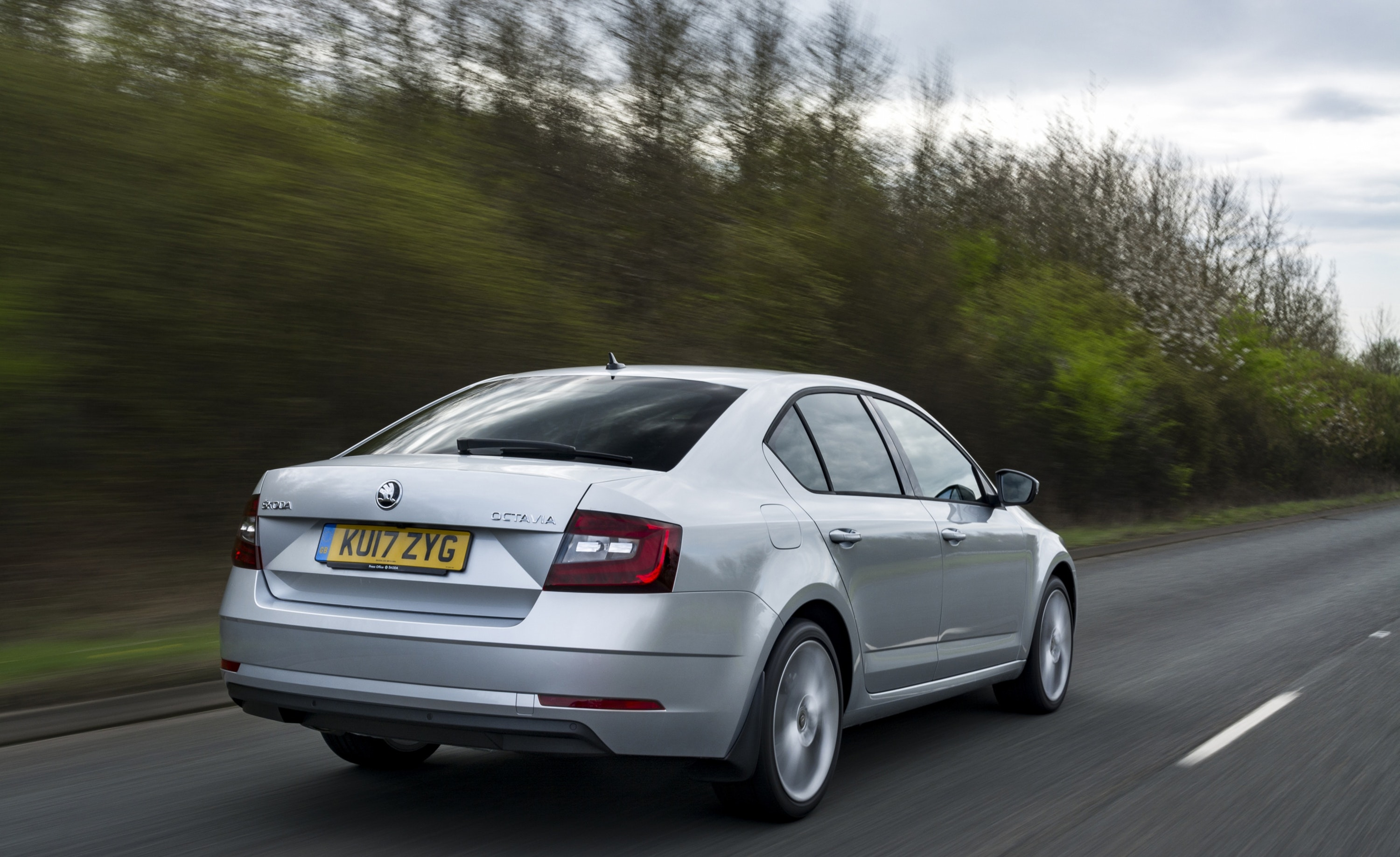 Silver Skoda Octavia driving away from you