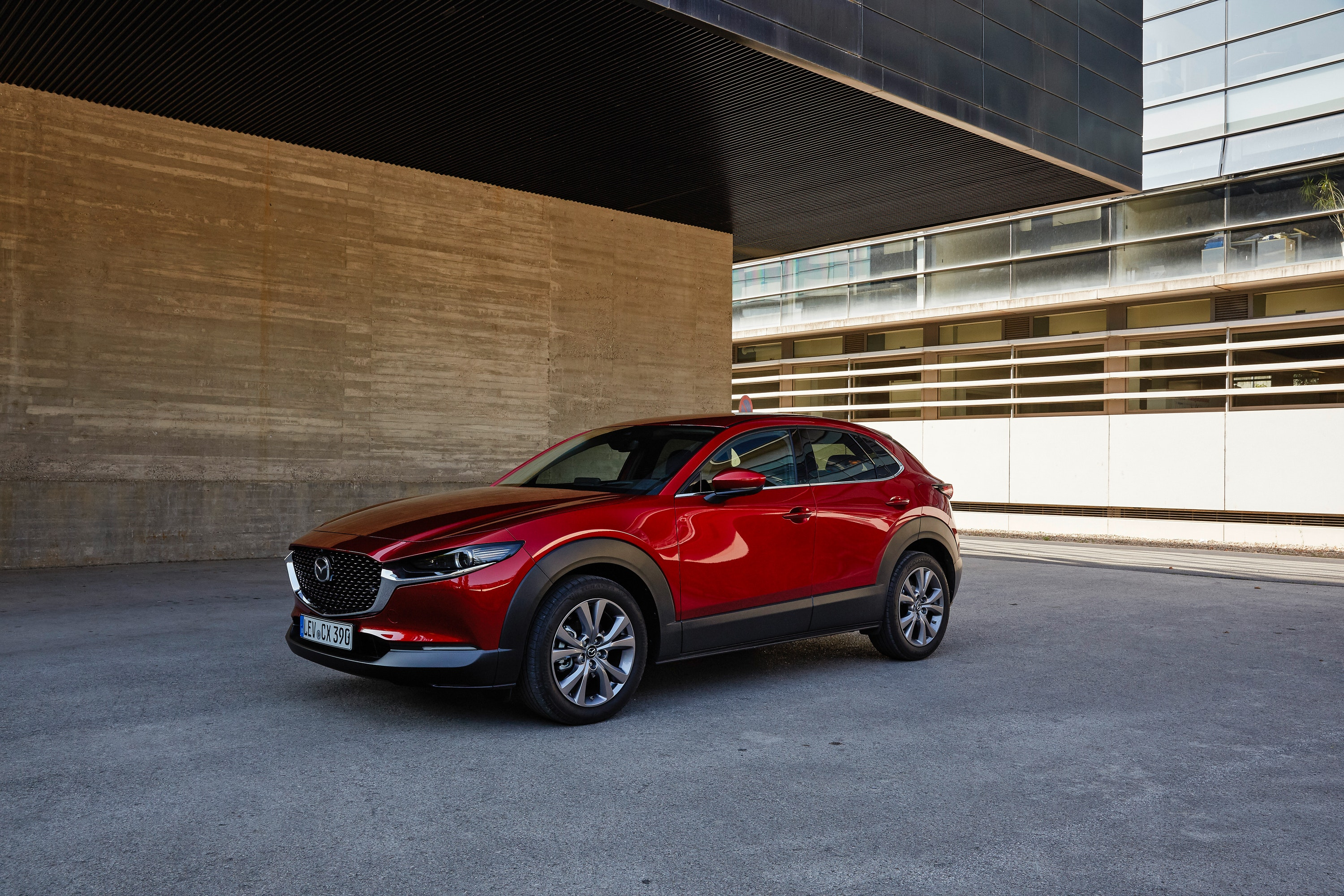 Side view of red Mazda CX-30